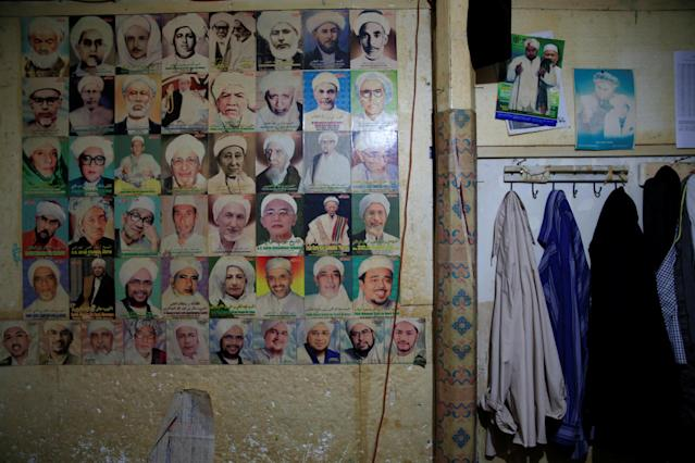 <p>Pictures of Indonesian clerics are displayed on the wall of a dormitory at Lirboyo Islamic boarding school in Kediri, Indonesia, May 20, 2018. (Photo: Beawiharta/Reuters) </p>