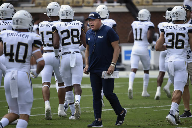 FILE - In this Saturday, Sept. 7, 2019, file photo, Georgia Tech head coach Geoff Collins walks the field during warm ups before the start of an NCAA college football game against South Florida, in Atlanta. Collins has his first win at Georgia Tech, so that's out of the way. But two games into his coaching tenure, it still looks like a very difficult year on the Flats. (AP Photo/Jon Barash, File)