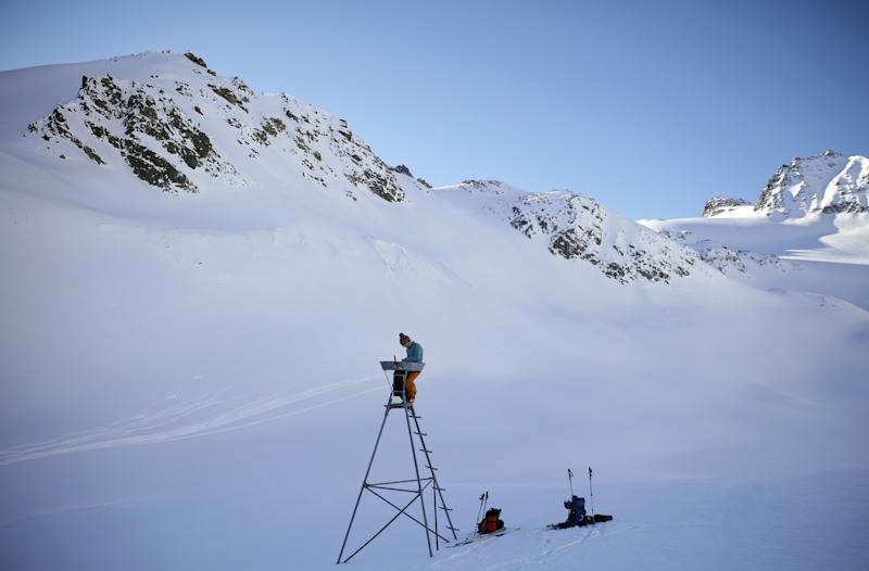 Glaciologist Andrea Fischer from the Austrian Institute for Interdisciplinary Mountain Research, checks a precipitation measuring station next to Jamtalferner glacier near Galtuer, Austria. (Photo: Lisi Niesner/Reuters)