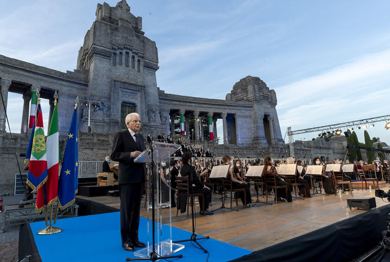"""Italian President Sergio Mattarella speaks in front of Bergamo's cemetery, Sunday, June 28, 2020. Italy bid farewell to its coronavirus dead on Sunday with a haunting Requiem concert performed at the entrance to the cemetery of Bergamo, the hardest-hit province in the onetime epicenter of the outbreak in Europe. President Sergio Mattarella was the guest of honor, and said his presence made clear that all of Italy was bowing down to honor Bergamo's dead, """"the thousands of men and women killed by a sickness that is still greatly unknown and continues to threaten the world."""" (Italian Presidency via AP)"""