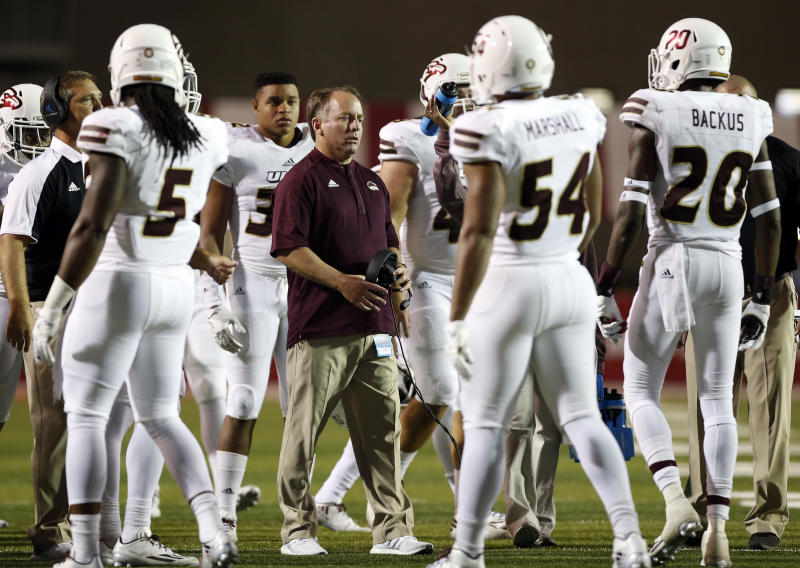 Louisiana-Monroe coach Matt Viator speaks to his players during a timeout in the second half of an NCAA college football game against New Mexico in Albuquerque, N.M., Saturday, Oct. 22, 2016. New Mexico won 59-17. (AP Photo/Andres Leighton)