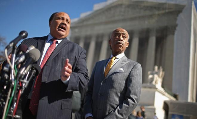 Martin Luther King III and Rev. Al Sharpton talk to reporters about the Voting Rights Act on Feb. 27.