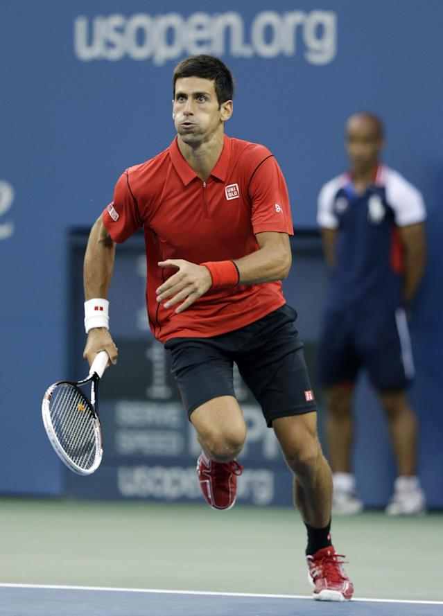 Novak Djokovic, of Serbia, chases down a a shot from Rafael Nadal, of Spain, during the men's singles final of the 2013 U.S. Open tennis tournament, Monday, Sept. 9, 2013, in New York. (AP Photo/Darron Cummings)