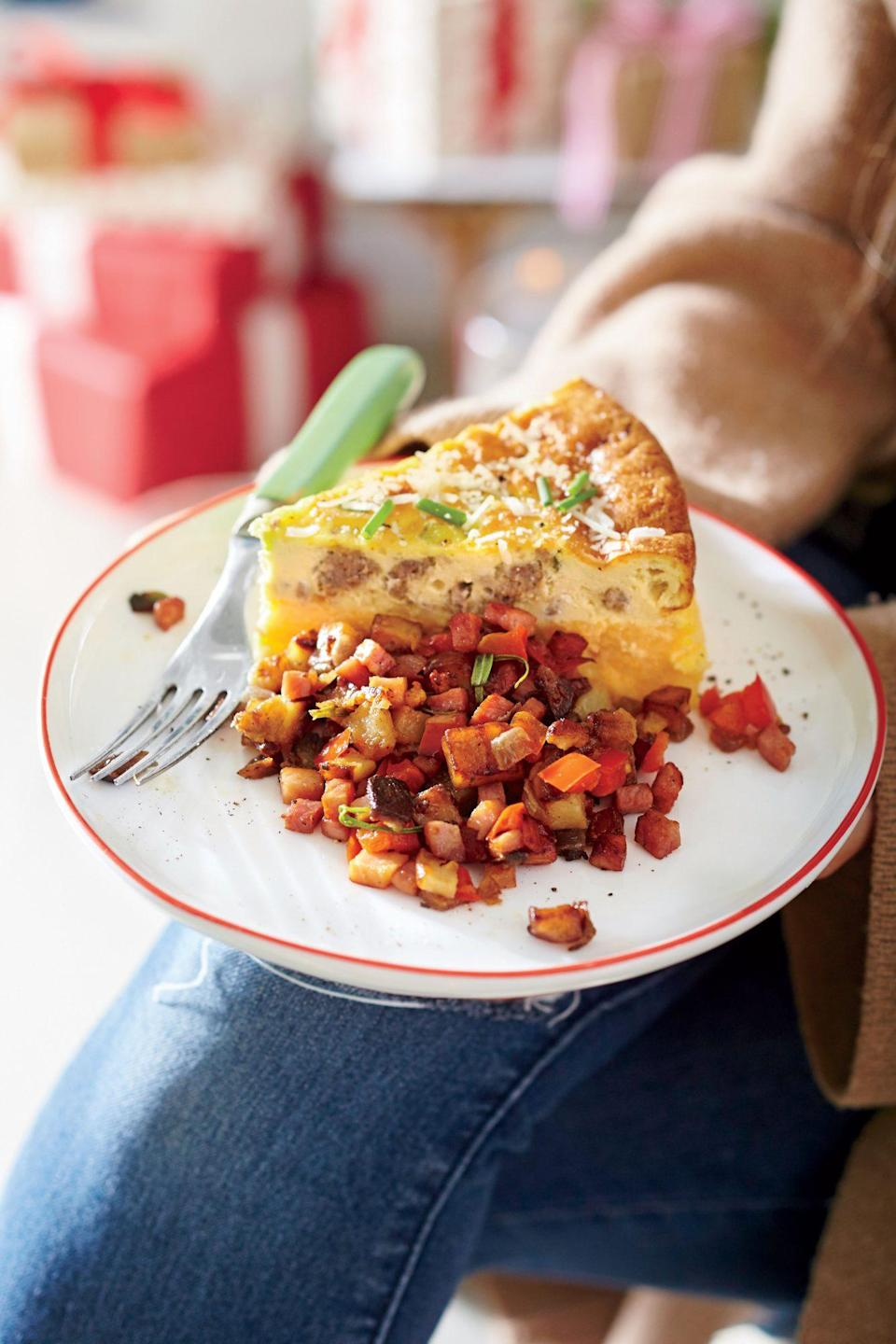 """<p><b>Recipe: </b><a href=""""https://www.southernliving.com/recipes/sausage-and-cheese-grits-quiche-recipe"""" rel=""""nofollow noopener"""" target=""""_blank"""" data-ylk=""""slk:Sausage-and-Cheese Grits Quiche"""" class=""""link rapid-noclick-resp""""><b>Sausage-and-Cheese Grits Quiche</b></a></p> <p>We added a Southern touch to this quiche by adding cheesy grits.</p>"""