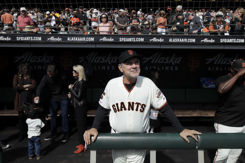 San Francisco Giants manager Bruce Bochy stands in the dugout before a baseball game between the Giants and the Los Angeles Dodgers in San Francisco, Sunday, Sept. 29, 2019. (AP Photo/Jeff Chiu)