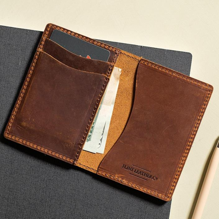"""Handcrafted in the USA, this slim wallet is made from 100% full grain leather and comes in three colors.<br> $75, Magnolia. <a href=""""https://shop.magnolia.com/collections/fathers-day/products/compact-wallet-coffee"""" rel=""""nofollow noopener"""" target=""""_blank"""" data-ylk=""""slk:Buy Now"""" class=""""link rapid-noclick-resp"""">Buy Now</a><br>"""