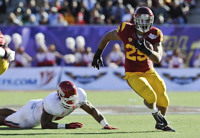 Southern California running back Ty Isaac (29) rushes the ball against Fresno State during the second quarter of the Royal Purple Bowl NCAA college football game, Saturday, Dec. 21, 2013, in Las Vegas. (AP Photo/David Cleveland)