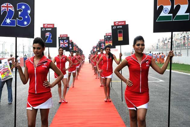 Indian Grand Prix grid girls stand on the track during the drivers' parade in the Formula One Indian Grand Prix at the Buddh International circuit in Greater Noida. (Toshifumi Kitamura/AFP/Getty Images)