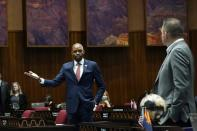 House Minority Leader Reginald Bolding, D-Laveen, left, talks with Arizona House Majority Leader Ben Toma, R-Peoria, during a vote on the Arizona budget Thursday, June 24, 2021, in Phoenix. (AP Photo/Ross D. Franklin)