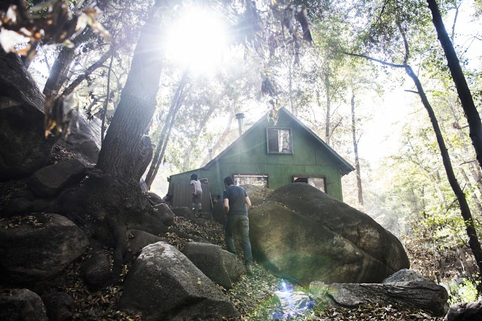 Members of the Jeevanjee family walk up to their cabin in Big Santa Anita Canyon.