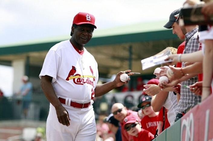 JUPITER, FL – MARCH 12: Hall of Famer Lou Brock of the St. Louis Cardinals signs autographs prior to his team playing against the Atlanta Braves at Roger Dean Stadium on March 12, 2012 in Jupiter, Florida. (Photo by Marc Serota/Getty Images)