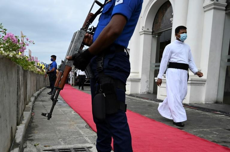 Navy personnel guard St. Anthony's Church during a service remembering Sri Lanka's Easter Sunday bombings in Colombo