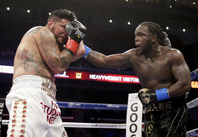 Bermane Stiverne, right, hits Chris Arreola during their rematch for the WBC heavyweight boxing title in Los Angeles, Saturday, May 10, 2014. Stiverne won the fight. (AP Photo/Chris Carlson)