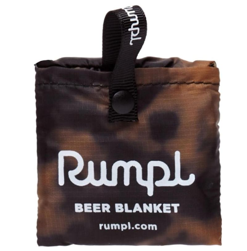 """Because beer and camping are an unbeatable combination, a blanket that will keep beer cold is a good idea. Get it <a href=""""https://www.rei.com/product/162654/rumpl-print-beer-blanket"""" target=""""_blank"""" rel=""""noopener noreferrer"""">at REI Co-op</a> for $8."""