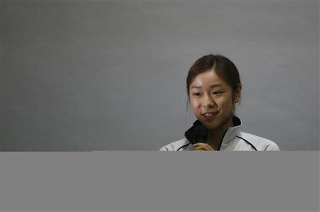 South Korean figure skater Kim Yuna speaks during meeting for Olympics at Taereung National Training Center in Seoul