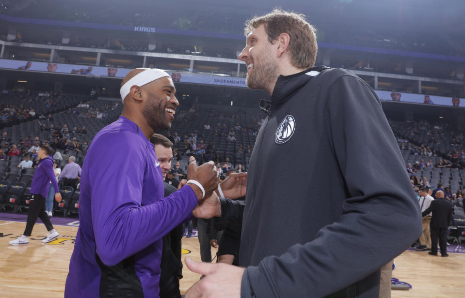 Dirk Nowitzki and Vince Carter will both return for their 21st seasons in the NBA. (Getty Images)
