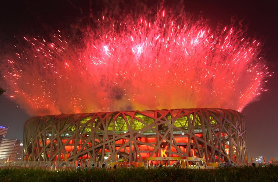 Host nation China put on a spectacular fireworks display over the National Stadium for the 2008 Beijing Summer Olympics Opening Ceremony. Too bad it wasn't all real. Because it was decided it was too dangerous to fly a helicopter to film to spectacle, some of the pyrotechnics were computer generated for Chinese television. (Photo by Stu Forster/Getty Images)