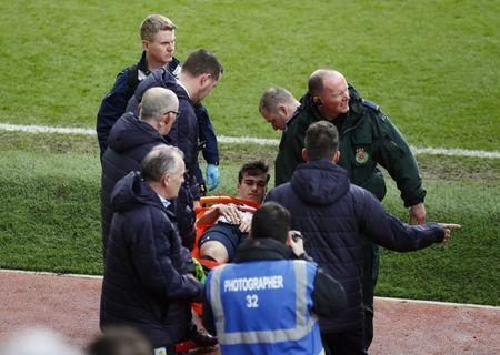 Tottenham's Harry Winks is stretchered off with an injury