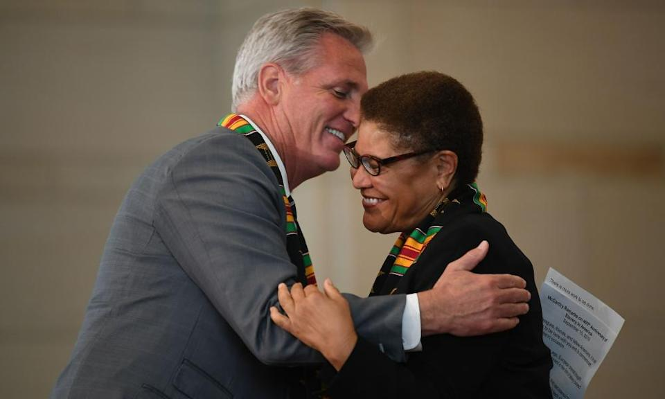 """<span class=""""element-image__caption"""">Kevin McCarthy hugs Bass during a ceremony to commemorate the 400th anniversary of the arrival of enslaved Africans in the US.</span> <span class=""""element-image__credit"""">Photograph: Mandel Ngan/AFP/Getty Images</span>"""