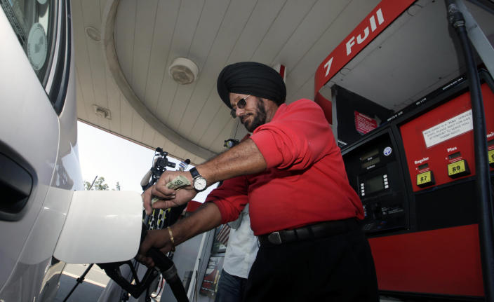 Lukoil service station worker Harbhasan Singh pumps gas Wednesday, Sept. 12, 2012, in South Plainfield, N.J., for regular customer Tiffany Price who still bought gas in support, even though it was more than $8 a gallon. More than 50 Lukoil gas stations in New Jersey and Pennsylvania were jacking up prices to more than $8 a gallon Wednesday to protest what they say are unfair pricing practices by Lukoil North America that they say leave them at a competitive disadvantage. (AP Photo/Mel Evans)