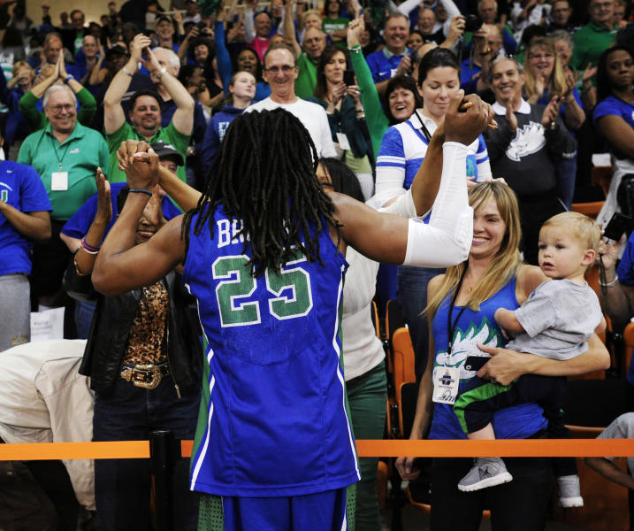 Florida Gulf Coast's Sherwood Brown (25) greets his mother, Angela Brown, in the stands after his team defeated Mercer in an NCAA college basketball game for the Atlantic Sun men's tournament championship, in Macon, Ga., Saturday, March 9, 2013. Florida Gulf Coast won 88-75. (AP Photo/Woody Marshall)