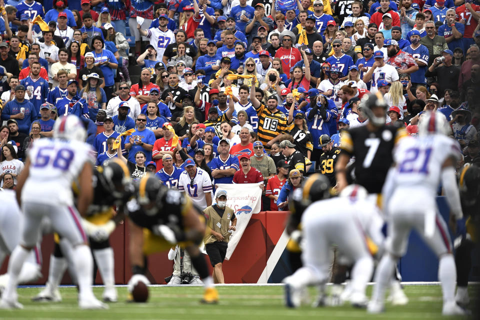 Fans watch the first half of an NFL football game between the Buffalo Bills and the Pittsburgh Steelers in Orchard Park, N.Y., Sunday, Sept. 12, 2021. (AP Photo/Adrian Kraus)