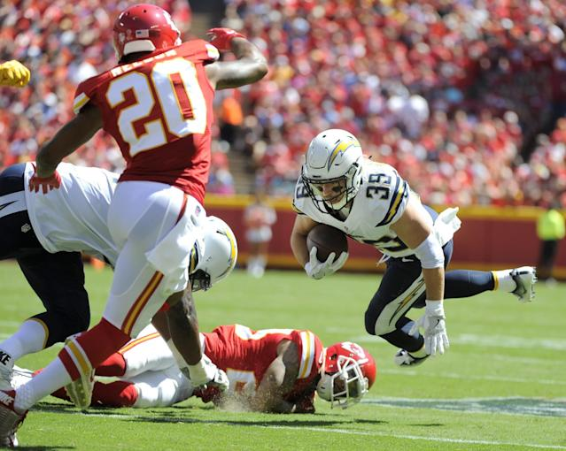 <p>San Diego Chargers running back Danny Woodhead (39) is tripped by Kansas City Chiefs defensive back Phillip Gaines, bottom, with defensive back Steven Nelson (20) closing in, during the first half of an NFL football game in Kansas City, Mo., Sunday, Sept. 11, 2016. (AP Photo/Ed Zurga) </p>