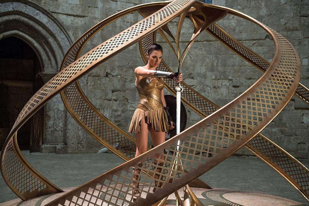 <p>Diana (Gal Gadot) enters Themyscira's inner sanctum to retrieve the magical shield and the blade, both forged by Hephaeastus. The sword was a gift from Zeus to the Amazons and, as its name suggests, has the power to take down a god. (Photo: Warner Bros.) </p>