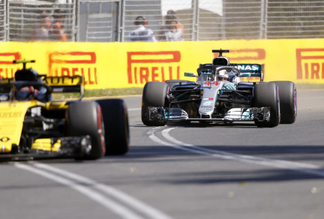 Mercedes driver Lewis Hamilton of Britain, right, comes up behind another car during the first practice session at the Australian Formula One Grand Prix in Melbourne, Friday, March 23, 2018. The first race of the 2018 seasons is on Sunday. (AP Photo/Asanka Brendon Ratnayake)