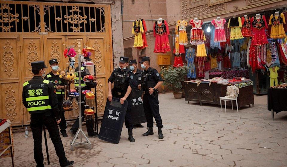 Police officers stand guard in the old city in Kashgar, Xinjiang Uygur autonomous region, on May 3. Photo: Reuters