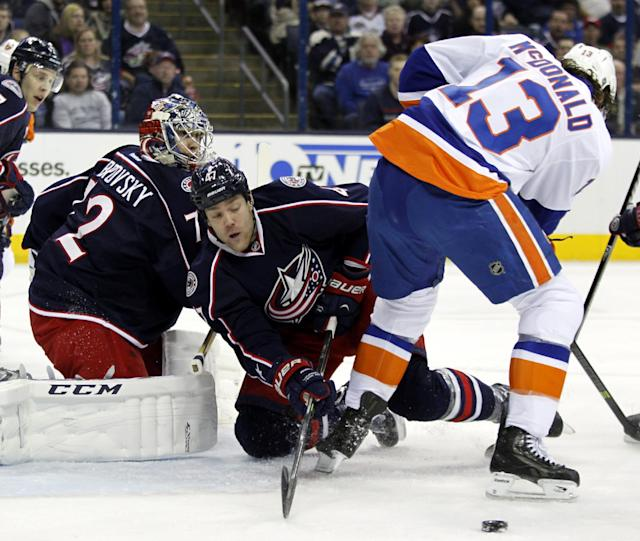 Columbus Blue Jackets' Dalton Prout (47) clears the puck away from New York Islanders' Colin McDonald (13) as Blue Jackets goalie Sergi Bobrovsky (72), of Russia, looks on in the first period of an NHL hockey game in Columbus, Ohio, Sunday, April 6, 2014. (AP Photo/Paul Vernon)