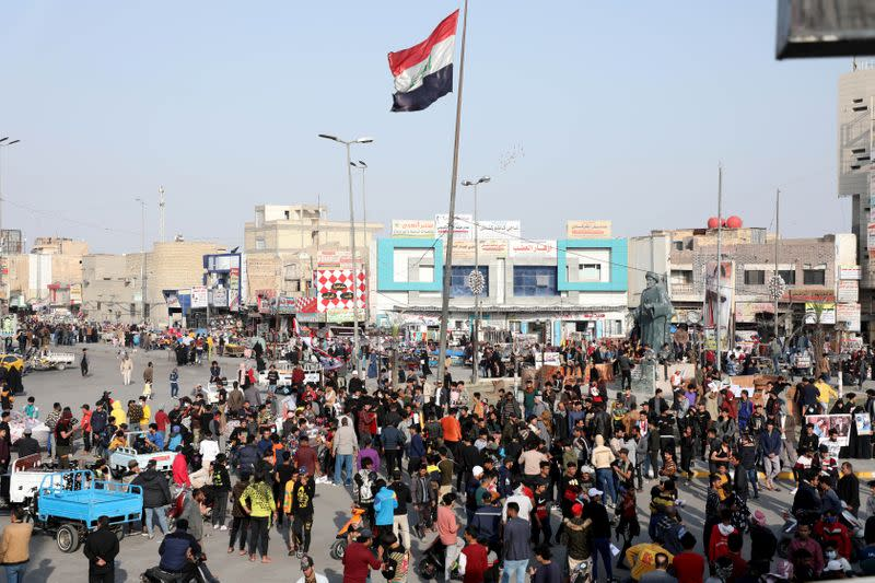 Iraqi demonstrators take part in ongoing anti-government protests in Nassiriya