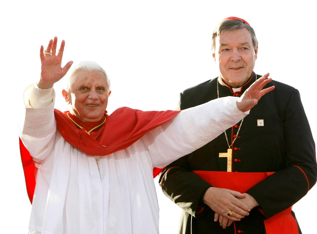 FILE PHOTO - Pope Benedict XVI (L) acknowledges the crowd of World Youth Day pilgrims before giving an address in Sydney July 17, 2008, as Australia's senior Catholic cleric Cardinal George Pell looks on.   REUTERS/Mick Tsikas/File Photo