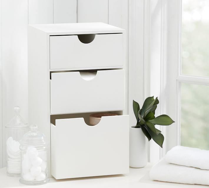 "Keep all your paperwork, folders, and files out of the way and out of your mind with this organizer's dream storage system. <br><br><strong><em><a href=""https://www.potterybarn.com/shop/bath/bath-storage/"" rel=""nofollow noopener"" target=""_blank"" data-ylk=""slk:Shop Pottery Barn"" class=""link rapid-noclick-resp"">Shop Pottery Barn</a></em></strong> <br><br><strong>Pottery Barn</strong> Under the Vanity Storage, $, available at <a href=""https://go.skimresources.com/?id=30283X879131&url=https%3A%2F%2Fwww.potterybarn.com%2Fproducts%2Funder-the-console-storage%2F%3F"" rel=""nofollow noopener"" target=""_blank"" data-ylk=""slk:Pottery Barn"" class=""link rapid-noclick-resp"">Pottery Barn</a>"