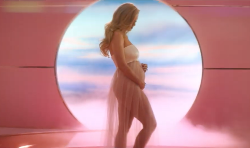 Katy Perry revealing her pregnancy in her music video for 'Never Worn White'.
