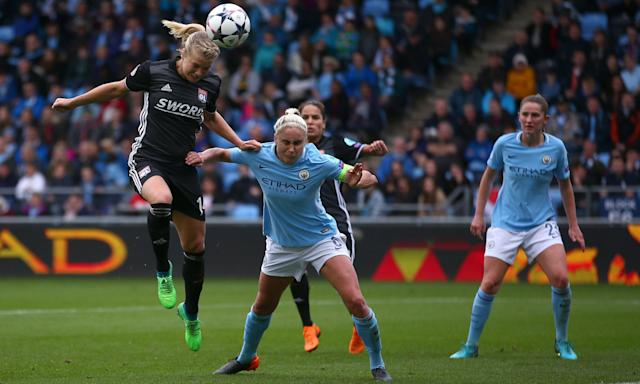 Lyon's Ada Hegerberg (left) wins the ball ahead of Manchester City's Steph Houghton during the Uefa Women's Champions League, semi-final, first leg at the City Football Academy.