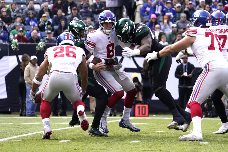 EAST RUTHERFORD, NJ - NOVEMBER 10: New York Giants Quarterback Daniel Jones (8) fumbles the ball to New York Giants Running Back Saquon Barkley (26) with New York Jets Linebacker Jordan Jenkins (48) and New York Jets Safety Jamai Adams (33) applying pressure during the first half of the National Football League game between the New York Giants and the New York Jets on November 10, 2019, at MetLife Stadium in East Rutherford, NY. (Photo by Gregory Fisher/Icon Sportswire via Getty Images)