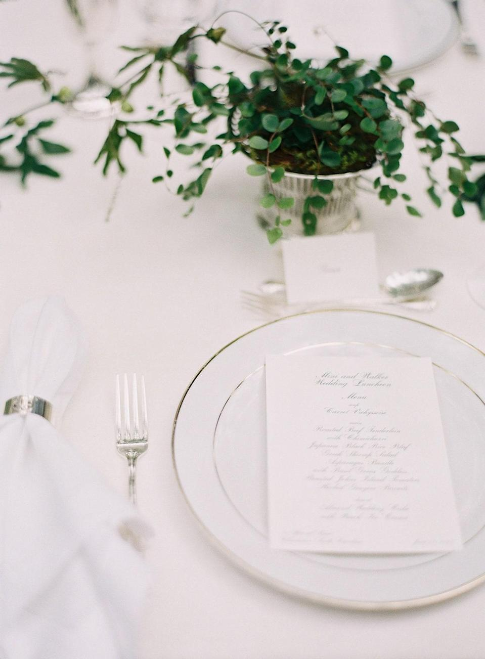 I loved keeping the table setting simple, using white linen and silver and then mixing greenery and flowers to create little mini arrangements.