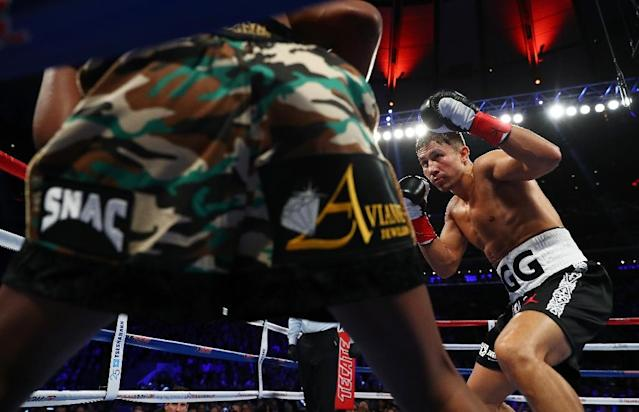 Gennady Golovkin knocks down Daniel Jacobs in the fourth round during their Championship fight for Golovkin's WBA/WBC/IBF middleweight title, at Madison Square Garden in New York, on March 18, 2017 (AFP Photo/Al Bello)