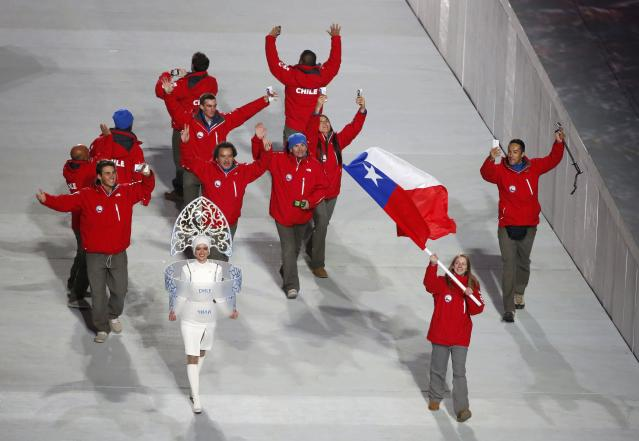 Chile's flag-bearer Dominique Ohaco leads her country's contingent during the athletes' parade at the opening ceremony of the 2014 Sochi Winter Olympics, February 7, 2014. REUTERS/Lucy Nicholson (RUSSIA - Tags: OLYMPICS SPORT)
