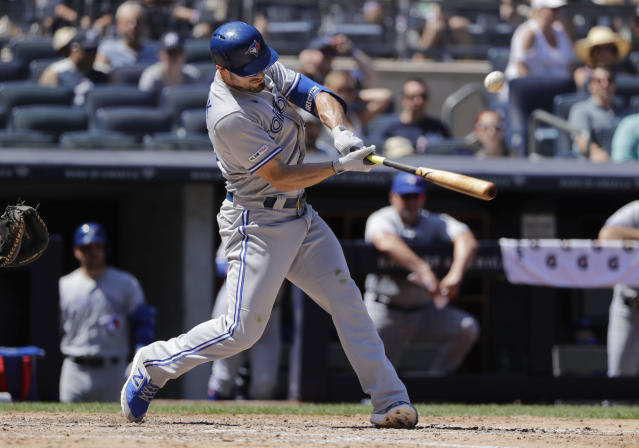Toronto Blue Jays' Randal Grichuk follows through on a two-run single during the sixth inning of a baseball game against the New York Yankees Saturday, July 13, 2019, in New York. (AP Photo/Frank Franklin II)