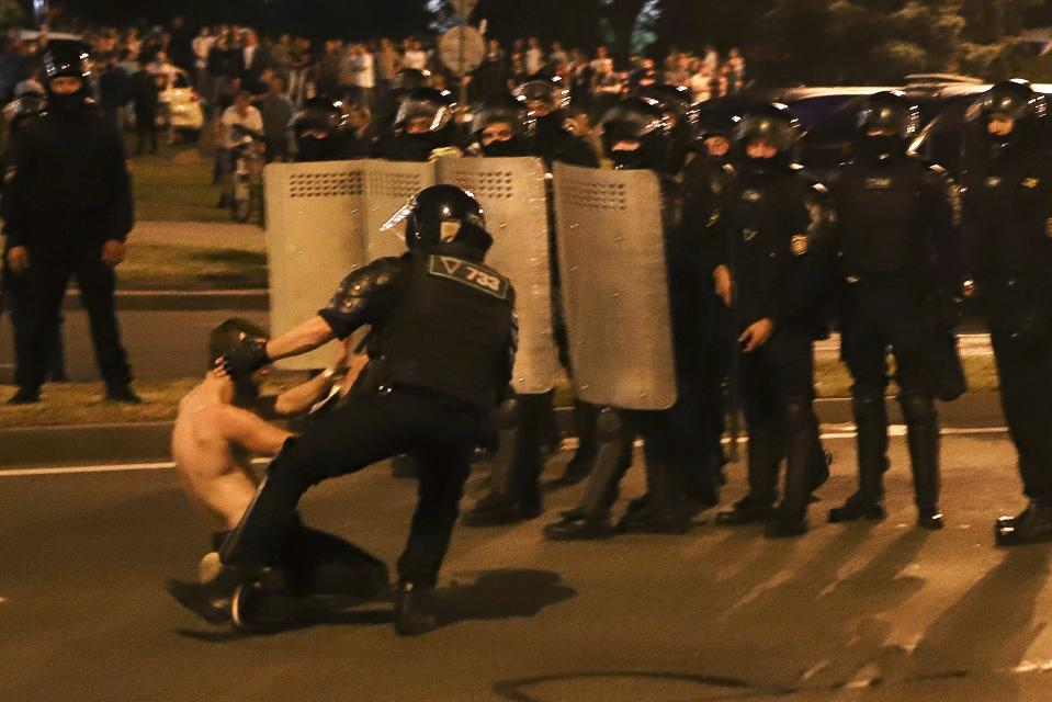 FILE - In this file photo taken on Monday, Aug. 10, 2020, a police officer detains a protester after the presidential election in Minsk, Belarus. Hundreds of people released from custody after a violent crackdown on protests in Belarus are sharing their accounts of harsh treatment at the hands of police. (AP Photo, File)