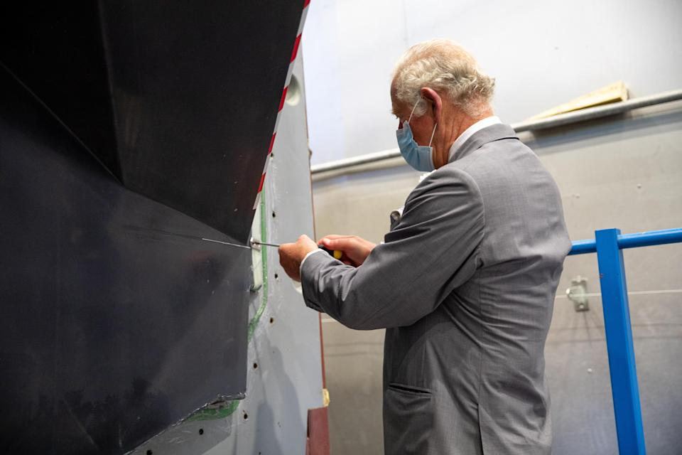 The Prince of Wales attaching the Magpie plaque