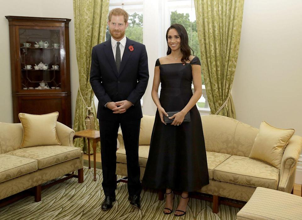 """<p><a href=""""https://www.townandcountrymag.com/society/tradition/g24280412/prince-harry-meghan-markle-new-zealand-royal-tour-day-1-photos/"""" rel=""""nofollow noopener"""" target=""""_blank"""" data-ylk=""""slk:On their first night in New Zealand"""" class=""""link rapid-noclick-resp"""">On their first night in New Zealand</a>, Harry and Meghan attended an event to celebrate the country's 125th anniversary of women's suffrage. The Duchess wore a black dress by Gabriela Hearst with a pair of Stuart Weitzman heels for the formal occasion.</p>"""