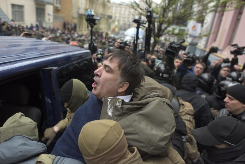 Ukrainian Security Service officers detain Mikheil Saakashvili at his house in Kiev, Ukraine, Tuesday, Dec. 5, 2017. Ukraine's intelligence agency on Tuesday detained the former president of Georgia who has emerged as an anti-corruption campaigner in his new country but faced an angry backlash of protesters who would not let the officers to take him away. (AP Photo/Evgeniy Maloletka)