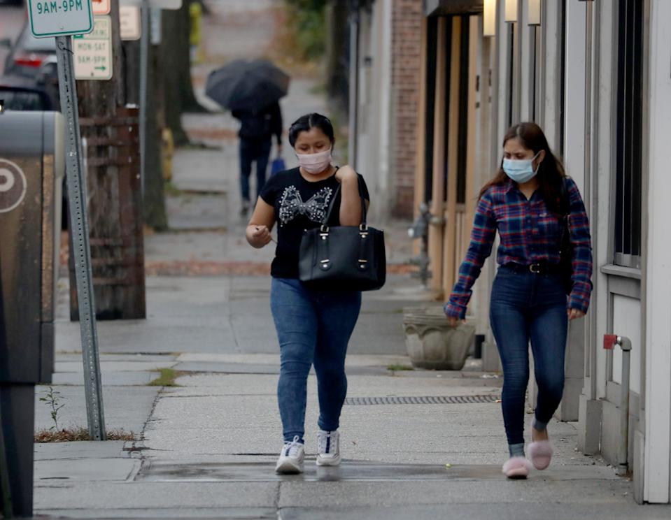 People walk with masks on in downtown Port Chester Nov. 11, 2020.