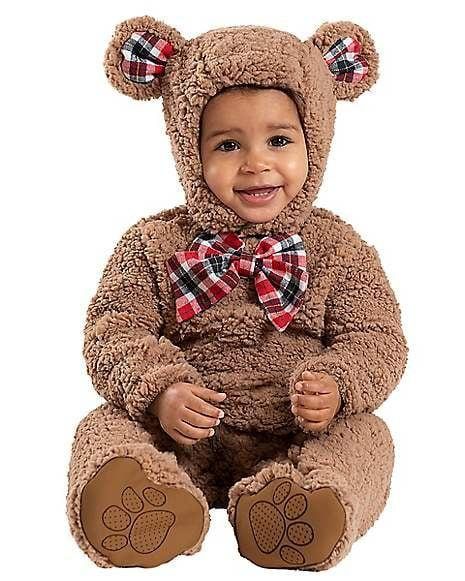 """<p>Your little one will stay cute and cozy in this <a href=""""https://www.popsugar.com/buy/Baby-Cuddly-Bear-Costume-475299?p_name=Baby%20Cuddly%20Bear%20Costume&retailer=spirithalloween.com&pid=475299&price=30&evar1=savvy%3Aus&evar9=46449394&evar98=https%3A%2F%2Fwww.popsugar.com%2Fphoto-gallery%2F46449394%2Fimage%2F46450586%2FBaby-Cuddly-Bear-Costume&list1=halloween%2Challoween%20costumes&prop13=api&pdata=1"""" rel=""""nofollow"""" data-shoppable-link=""""1"""" target=""""_blank"""" class=""""ga-track"""" data-ga-category=""""Related"""" data-ga-label=""""https://www.spirithalloween.com/product/halloween-costumes/toddler-costumes/view-all-toddler-costumes/baby-cuddly-bear-costume/pc/4742/c/798/sc/3992/176626.uts?currentIndex=24"""" data-ga-action=""""In-Line Links"""">Baby Cuddly Bear Costume</a> ($30).</p>"""