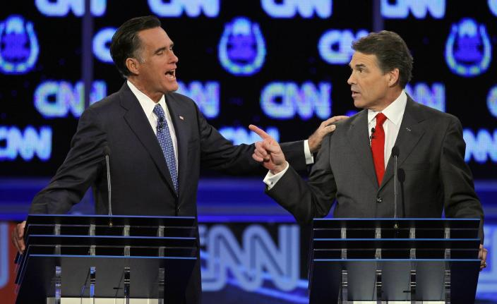 FILE - In this Oct. 18, 2011 file photo, Republican presidential candidates former Massachusetts Gov. Mitt Romney, left, and Texas Gov. Rick Perry speak during a Republican presidential debate in Las Vegas. Perry announced Monday, July 8, 2013, that he would not seek re-election as Texas governor next year. (AP Photo/Chris Carlson, File)