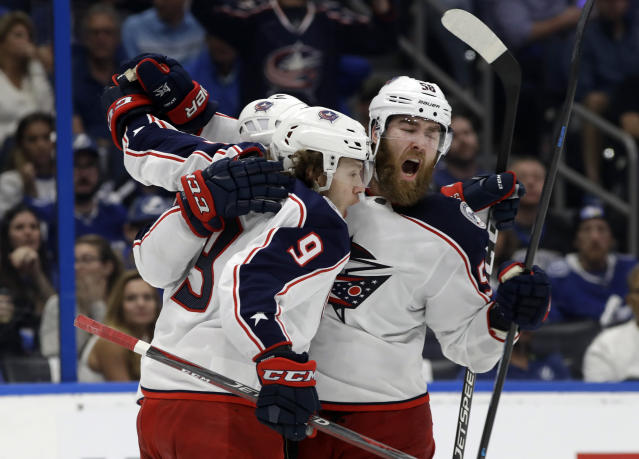 Columbus Blue Jackets left wing Artemi Panarin (9) celebrates his goal against the Tampa Bay Lightning with defenseman David Savard (58) during the third period of Game 2 of an NHL Eastern Conference first-round hockey playoff series Friday, April 12, 2019, in Tampa, Fla. (AP Photo/Chris O'Meara)