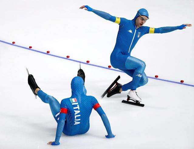 """Speed Skating - Pyeongchang 2018 Winter Olympics - Men's Team Pursuit Competition Finals - Gangneung Oval - Gangneung, South Korea - February 21, 2018. Nicola Tumolero and Riccardo Bugari of Italy fall after the race. REUTERS/Damir Sagolj SEARCH """"OLYMPICS BEST"""" FOR ALL PICTURES. TPX IMAGES OF THE DAY."""